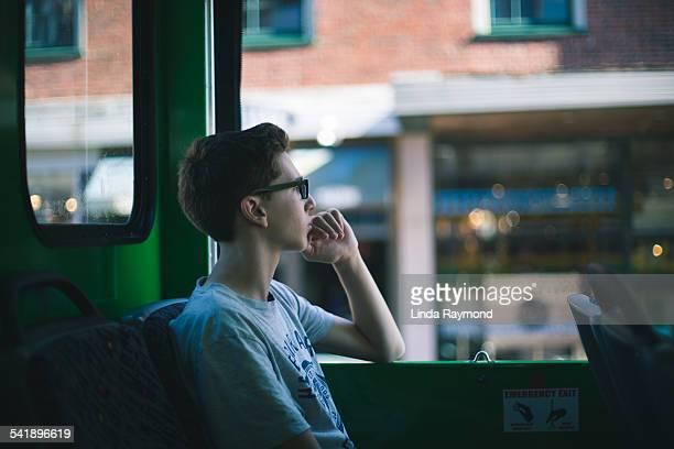 Boy sitting on a bus