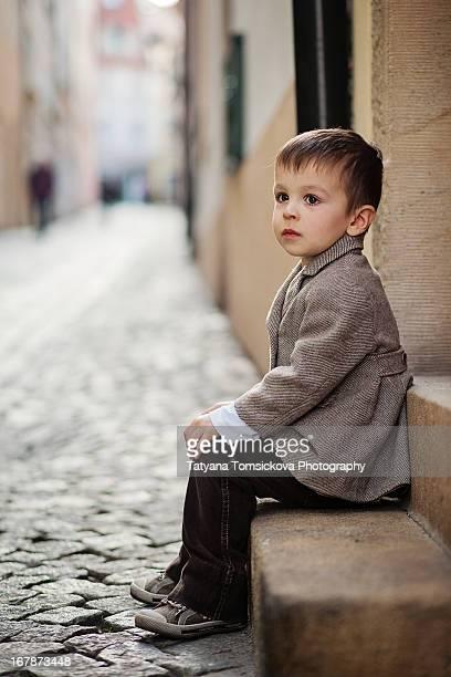 Boy, sitting on a doorstep