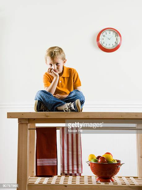 boy sitting on a kitchen table