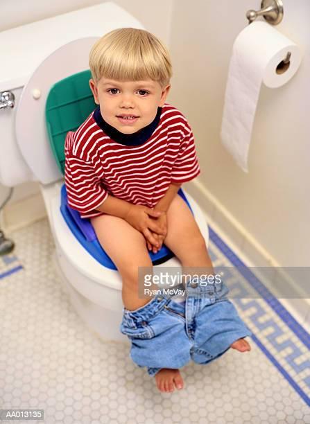 Boy Sitting on a Potty Chair