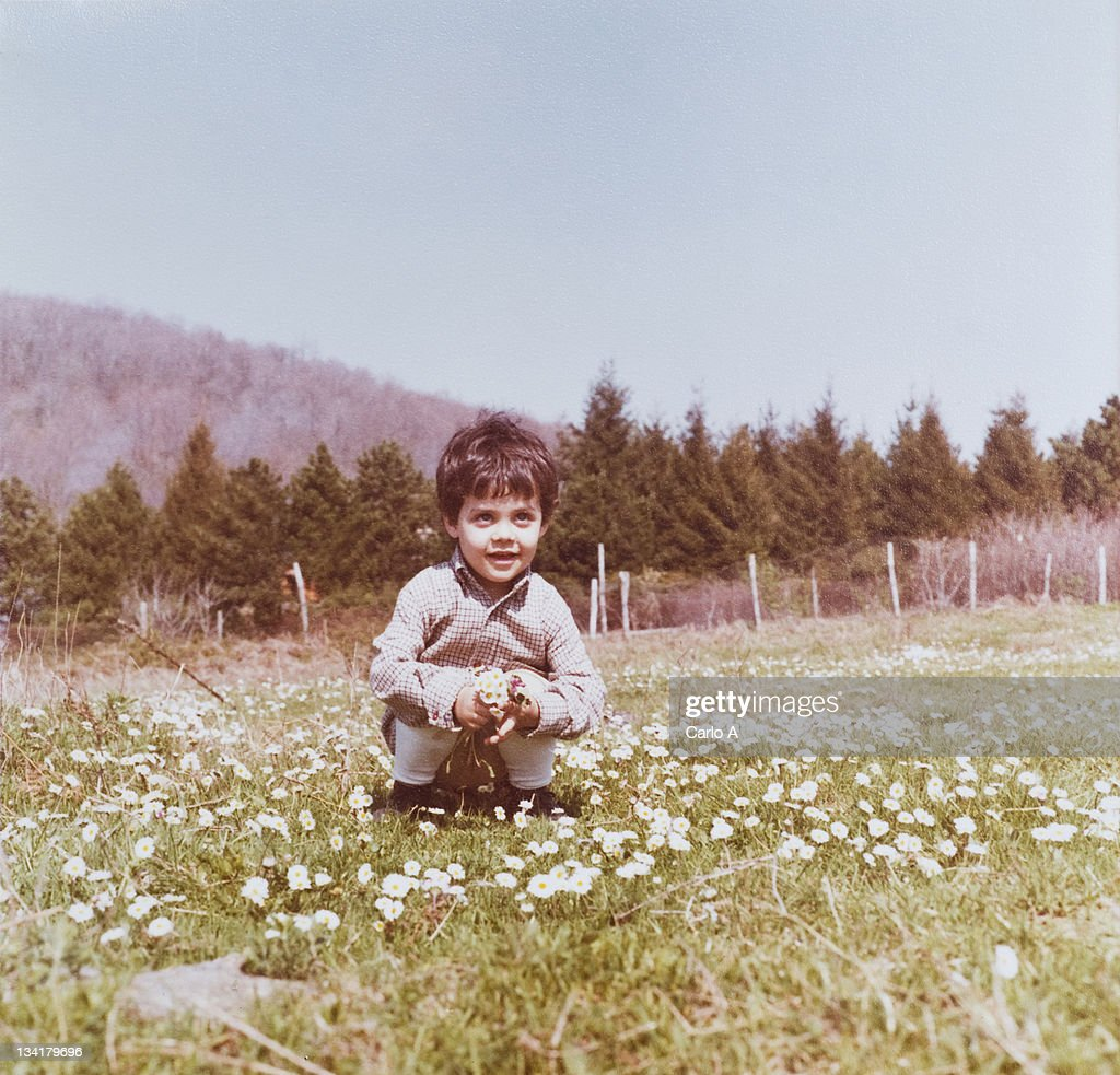 Boy sitting on grass : Stock Photo
