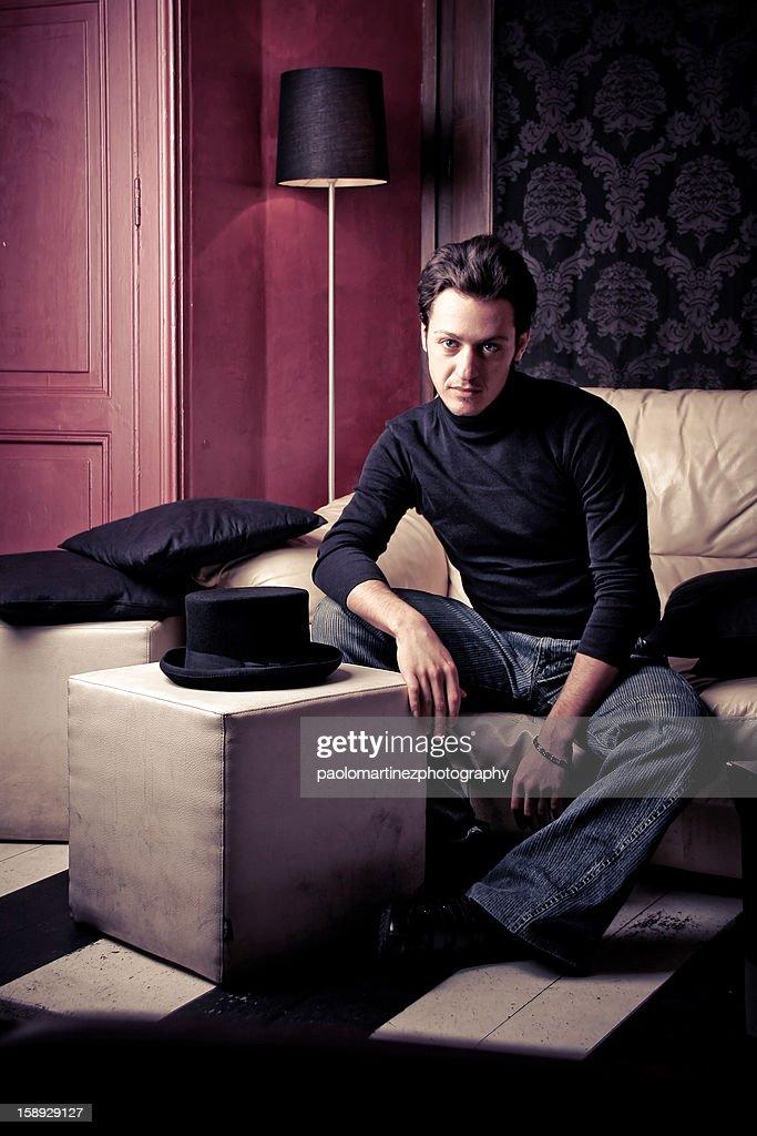 boy sitting on sofa : Stock Photo
