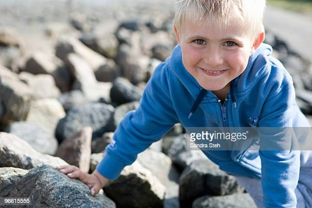 Boy sitting on stones