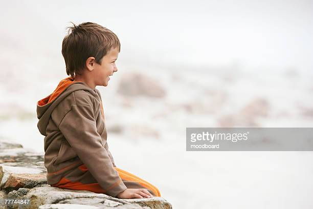 Boy Sitting on Wall