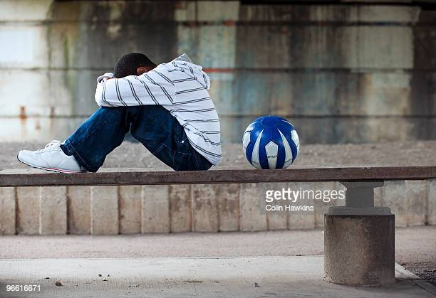 Boy sitting with ball