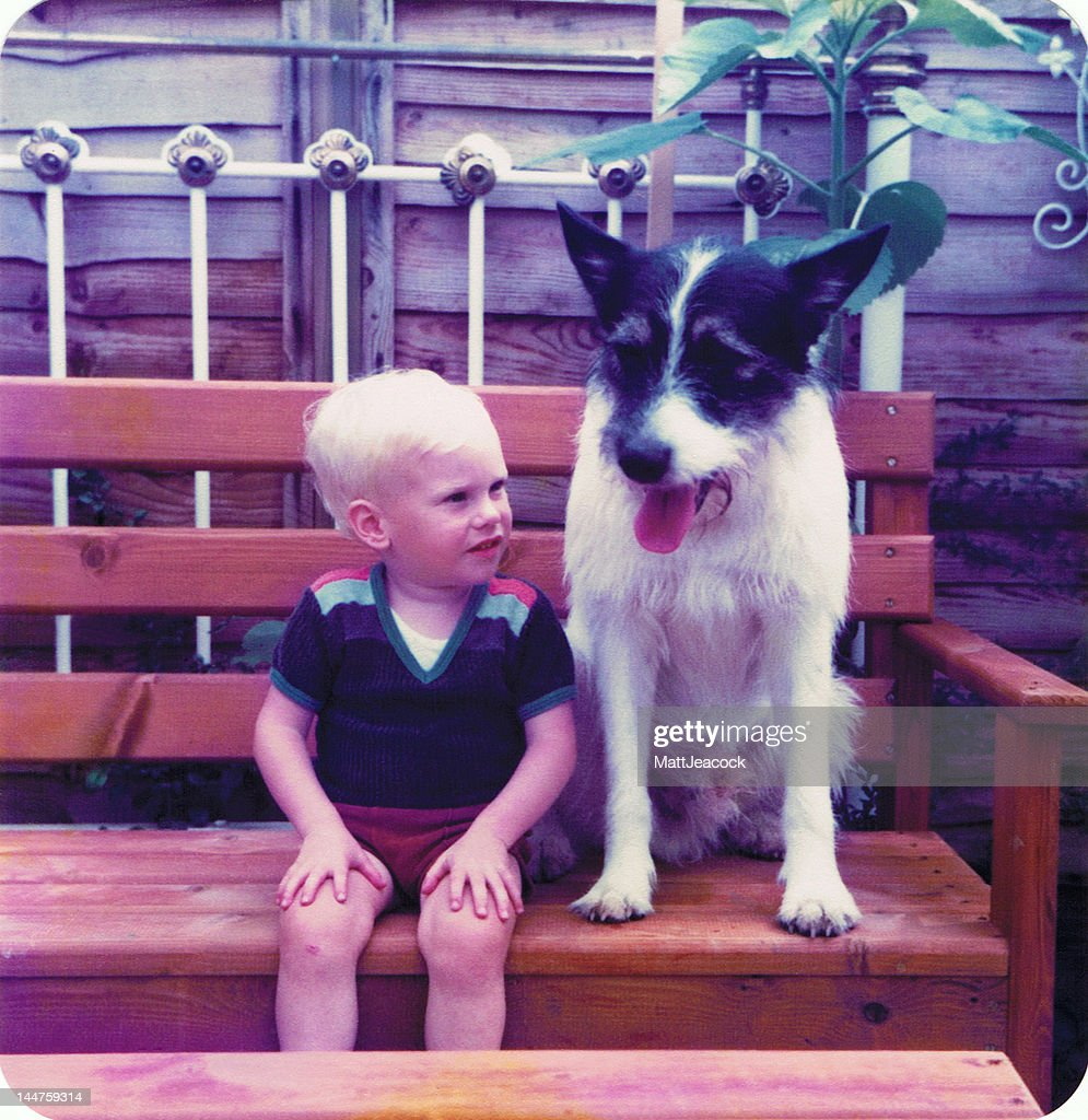 Boy sitting with dog : Stock Photo