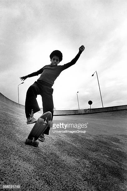 Boy skateboarding on a roundabout Wandsworth London UK 1977