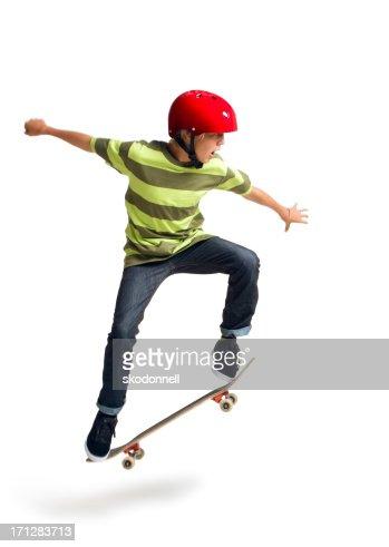 Boy Skateboarding on a White Background