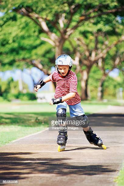 Boy skating on sidewalk
