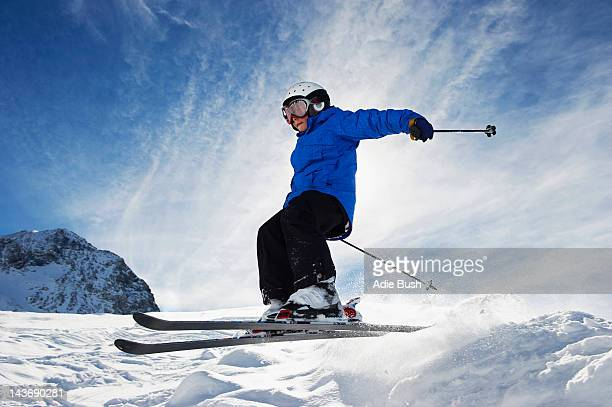 Boy skiing on snowy mountainside