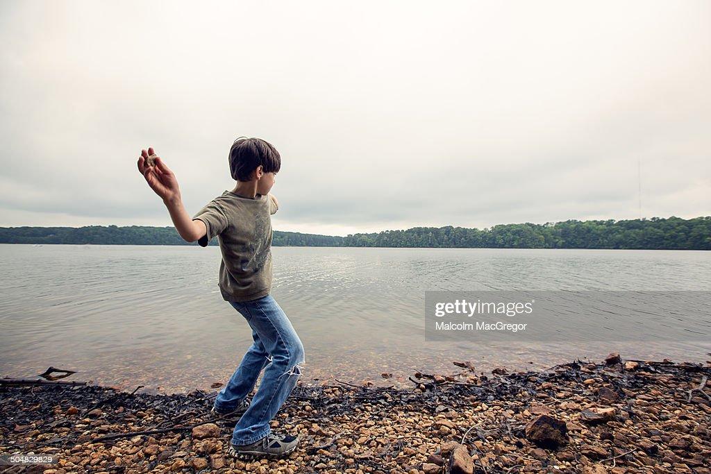 Boy skipping rocks.