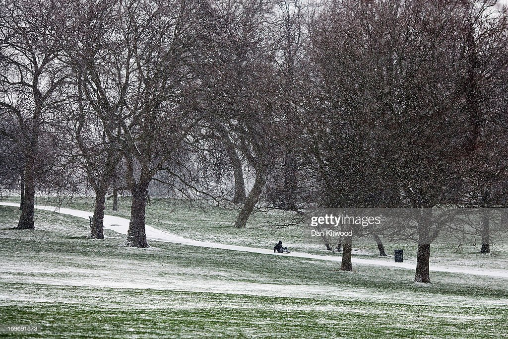 A boy sledges down a hill in Brockwell Park on January 18, 2013 in London, England. Widespread snowfall is affecting most of the UK with school closures and transport disruption. The Met Office has issued a red weather warning for parts of Wales, advising against all non-essential travel as up to 30cm of snow is expected to fall in some areas today.