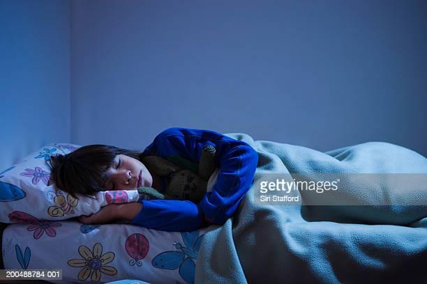 Boy (8-10) sleeping in bed