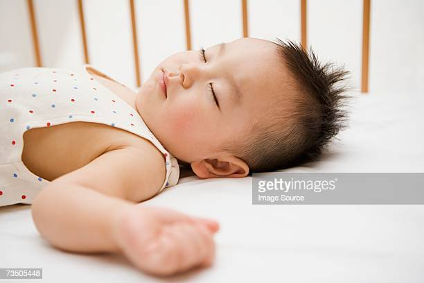 Boy sleeping in crib