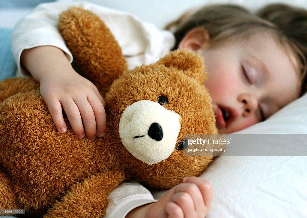 Boy sleeping with teddy bear : Stock Photo