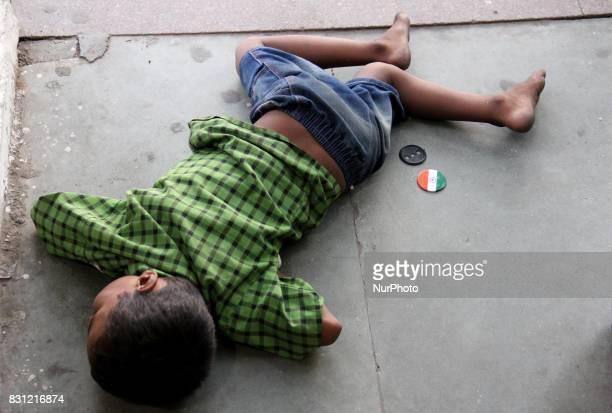 A Boy sleeps on the road side ahead of the Independence Day at Cannaught Place in New Delhi India on 14 August 2017