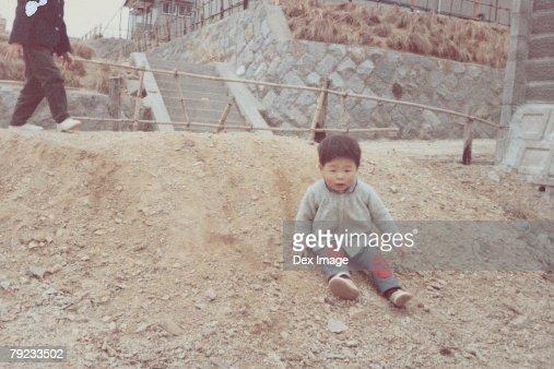 Boy sliding down a slope : Stock Photo
