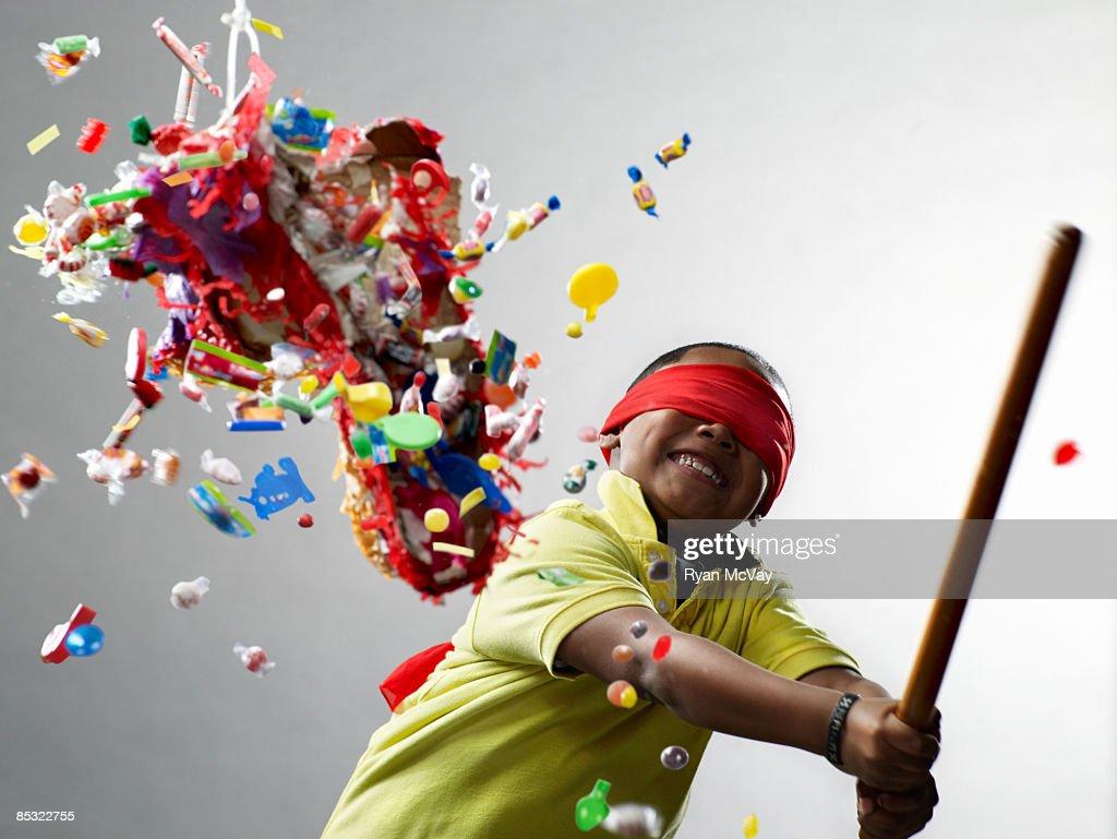 Boy smiling after hitting pinata : Stock Photo