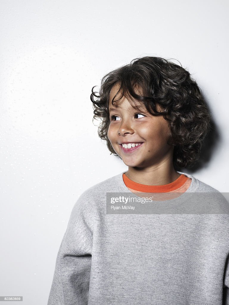 Boy smiling and looking to the side : Stock Photo