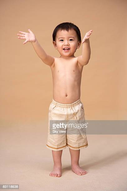 Boy smiling, arms outstretched