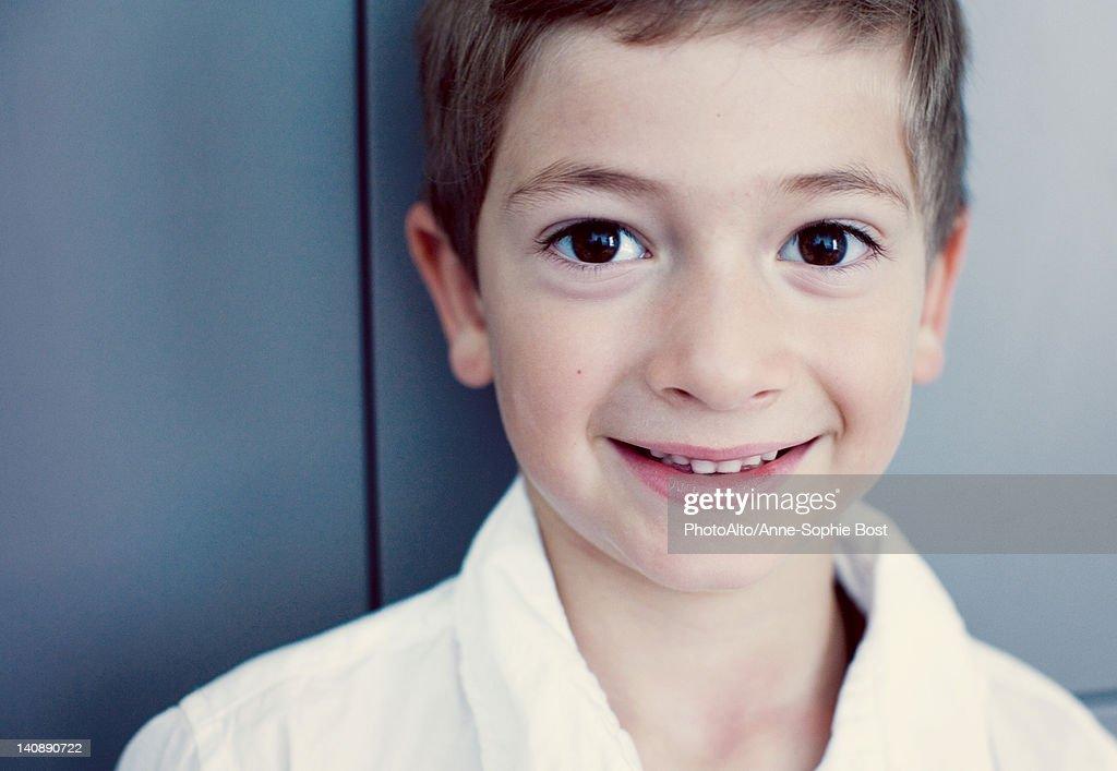 Boy smiling at camera, portrait : Stock Photo