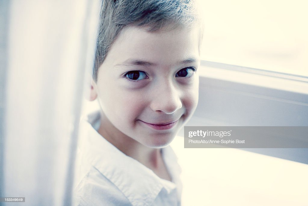 Boy smiling at camera, portrait : Stock Photo