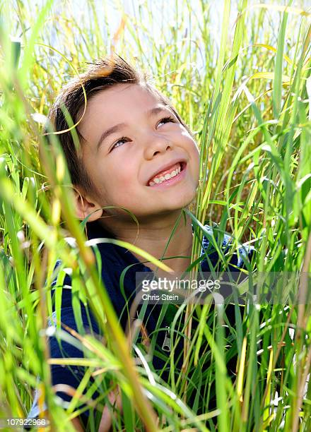 Boy smiling at the sun