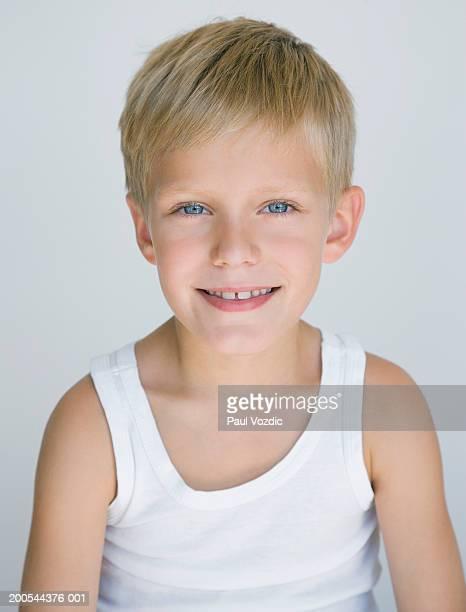 Boy (6-7) smiling, close-up, portrait