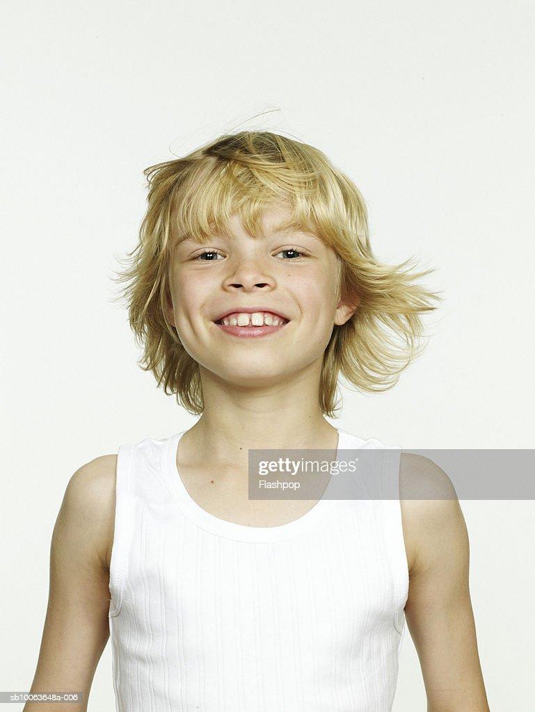 Boy (8-9) smiling, close-up, portrait