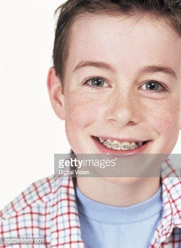 Boy (11-13) smiling, portrait, close-up