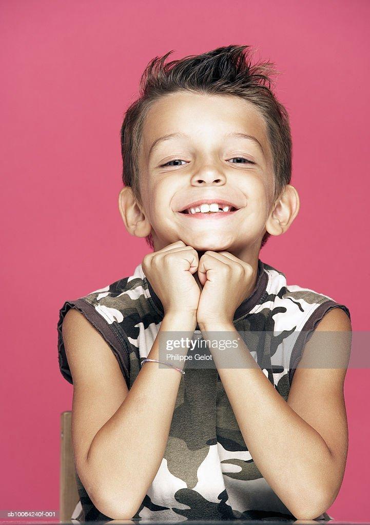Boy (6-7) smiling, portrait : Stock Photo