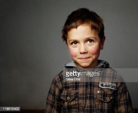 boy smiling shy at camera
