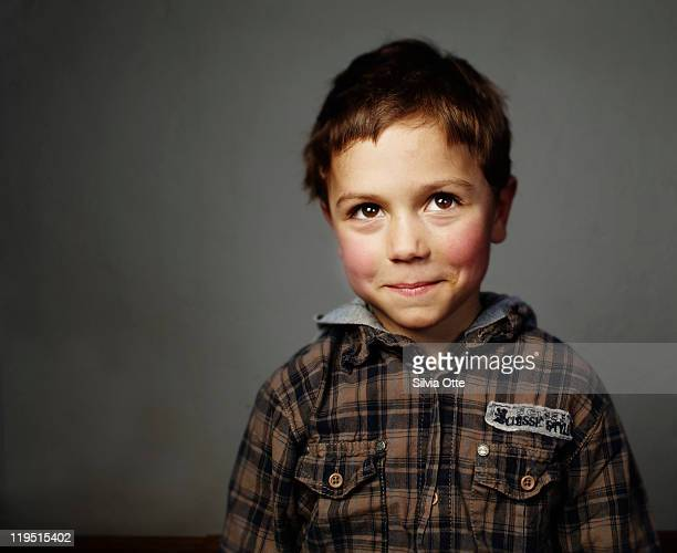 boy smiling shy at camera