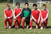 Boy soccer team portrait outdoors