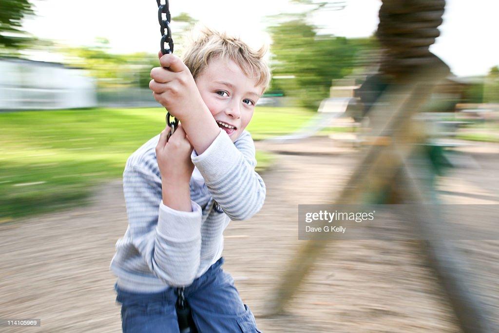 Boy spinning around : Stock Photo