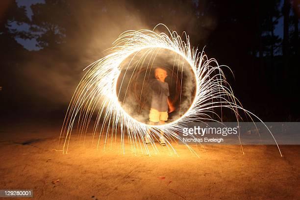Boy spinning firework sparklers