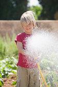 Boy spraying water