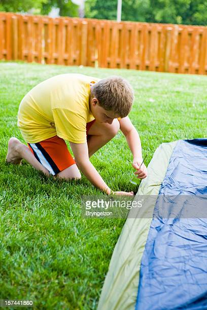 Boy Staking Tent