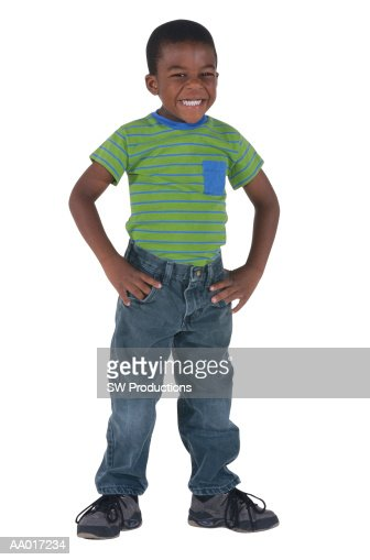 boy standing arms akimbo stock photo getty images
