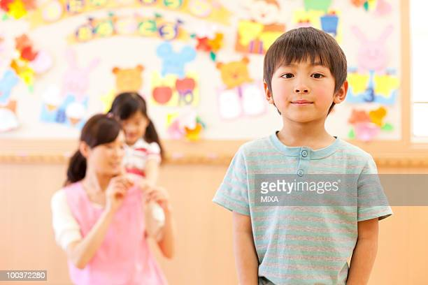 Boy Standing at Child Day-care Center