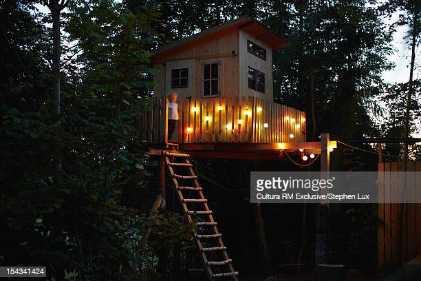 Boy standing in treehouse