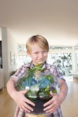 Boy standing next to a homemade terrarium