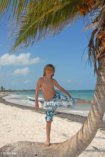 Boy standing on a palm tree