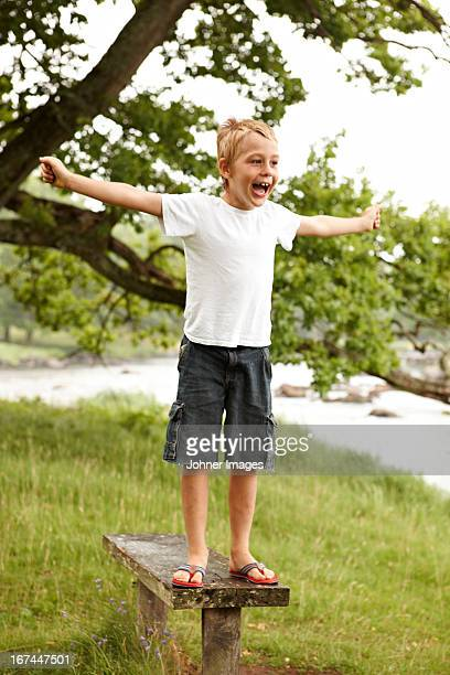 Boy standing on bench