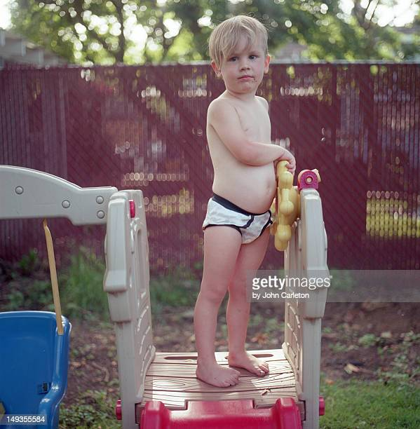 Boy standing on play structure