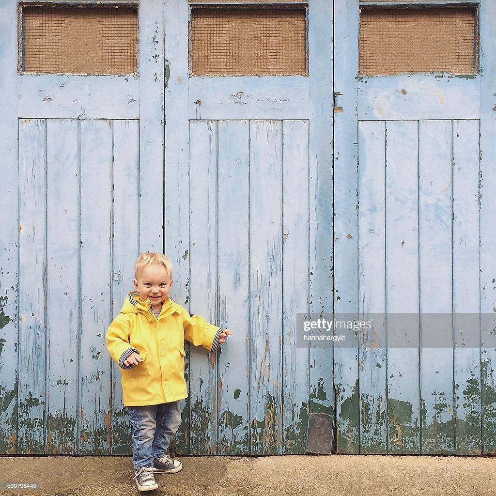 Boy standing outside garage