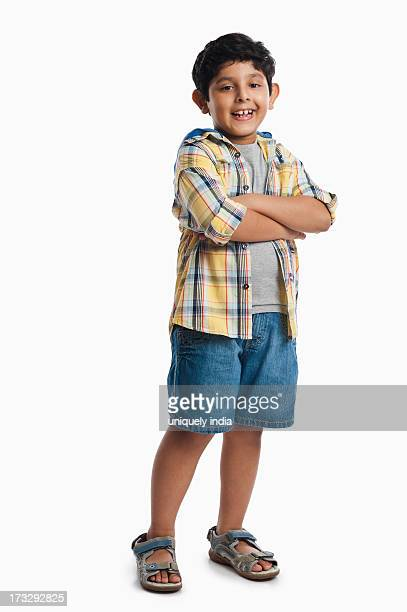Boy standing with his arms crossed