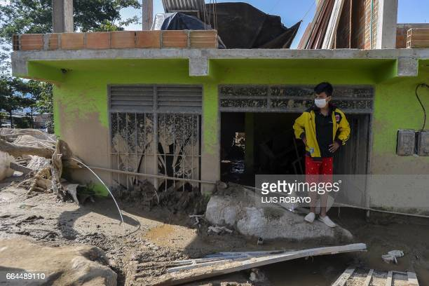 A boy stands amid rubble caused by mudslides due to heavy rains in Mocoa Putumayo department southern Colombia on April 4 2017 Colombian government...