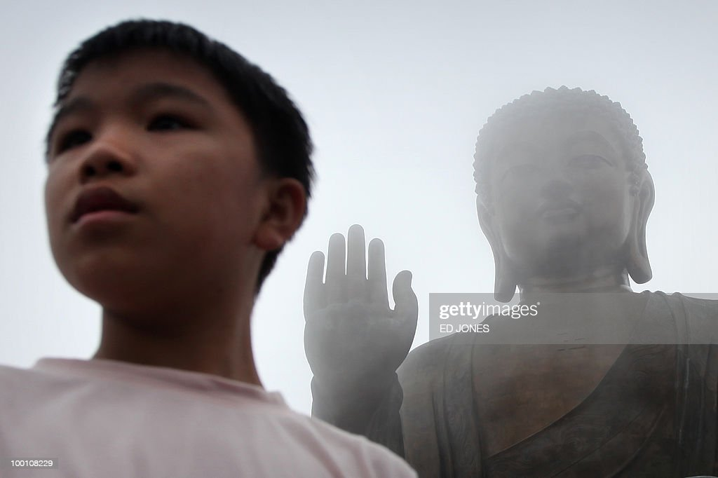 A boy stands before the Tian Tan Buddha statue, also known as the Big Buddha, on Lantau island in Hong Kong on May 21, 2010. Buddhists throughout Asia are celebrating the birthday of Siddhartha Gautama, the spiritual teacher who founded Buddhism. Hong Kong's Big Buddha statue was until 2007 the tallest of its kind, standing 34 metres (112 feet) tall.