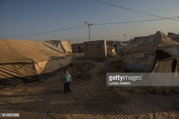 A boy stands outside a tent in Zaatari camp in Mafraq Province Jordan September 14 2013 There are roughly 120000 Syrian refugees living in the...